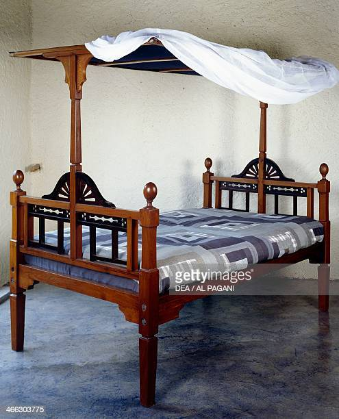 Teak and rosewood bed Colonial period AngloPortuguese origin India 19th century