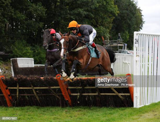 Teak ridden by Richard Johnson on their way to victory in the William Hill 80th Anniversary Handicap Hurdle at Cartmel Racecourse Cartmel Cumbria