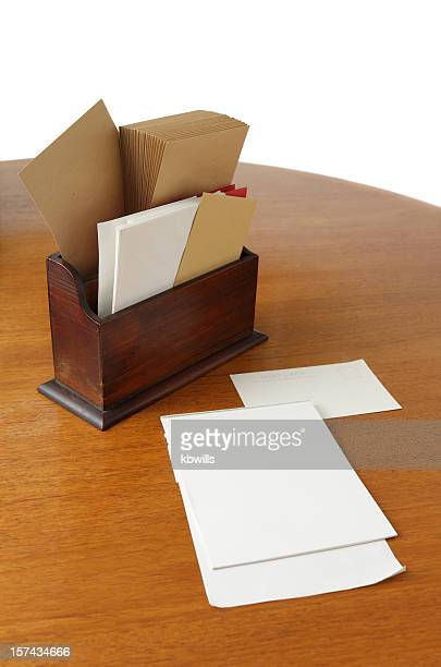teak wood table with stationery - envelopes, writing paper