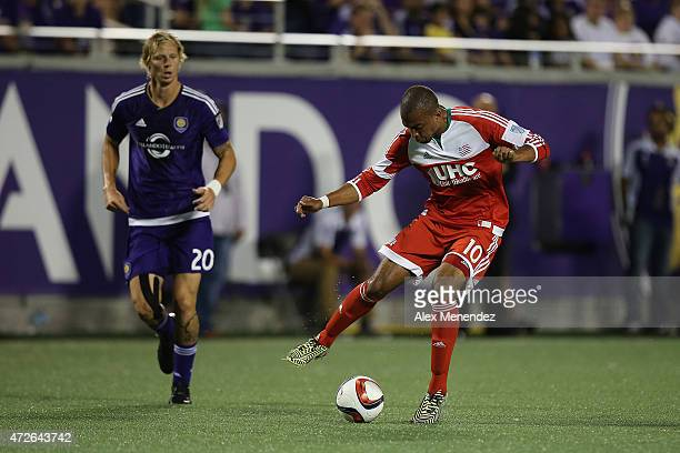 Teal Bunbury of New England Revolution dribbles the ball during an MLS soccer match between the New England Revolution and the Orlando City SC at the...