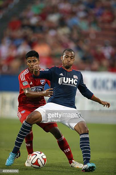 Teal Bunbury of New England Revolution fights with Moises Hernandez of FC Dallas to gain maintain control of the ball at Toyota Stadium on July 19...