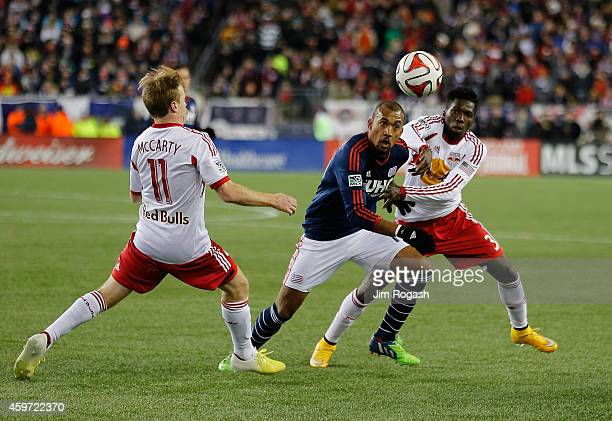 Teal Bunbury of New England Revolution keeps the ball from Dax McCarty and Ambroise Oyongo of New York Red Bulls in the second half during Leg 2 of...