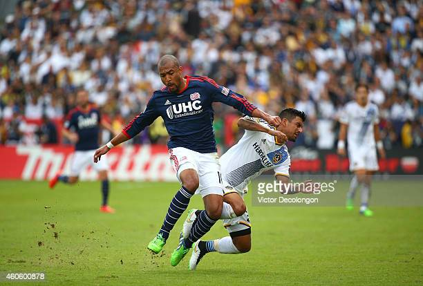 Teal Bunbury of the New England Revolution collides with AJ DeLaGarza of the Los Angeles Galaxy in the second half during 2014 MLS Cup at StubHub...