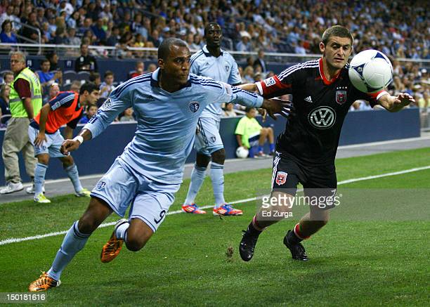 Teal Bunbury of the Sporting Kansas City and Chris Korb of the DC United chase down a loose ball in the second half at Livestrong Sporting Park on...
