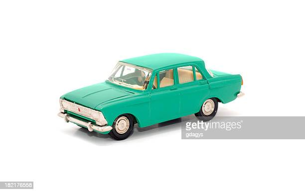 Teal toy car on white background