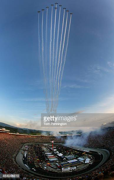 Team Aerodynamix performs a flyover before the start of the NASCAR Sprint Cup Series Irwin Tools Night Race at Bristol Motor Speedway on August 23...