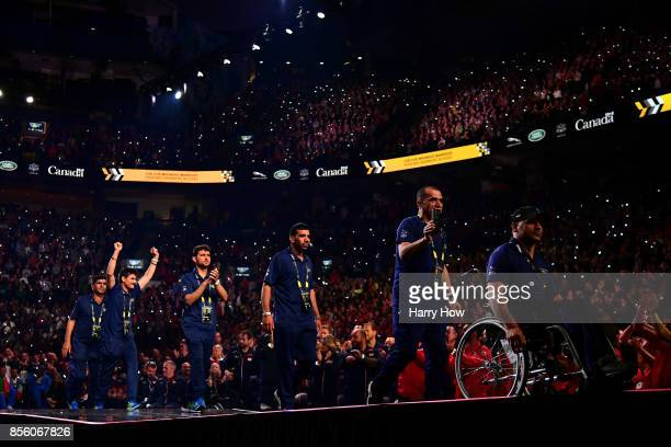Team Afghanistan walks on stage to receive the Land Rover Above and Beyond Award during the closing ceremony of the Invictus Games 2017 at Air Canada...