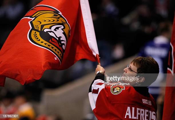 Team Alfredsson fan waves an Ottawa Senators flag during the 2012 Molson Canadian NHL AllStar Skills Competition between Team Alfredsson and Team...