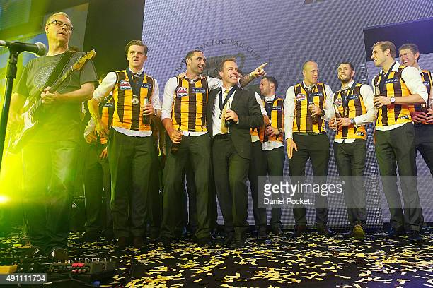 Team and coach join Daryl Braithwaite to perform his song Horses during the Hawthorn Hawks AFL Grand Final dinner at Crown Palladium on October 3...