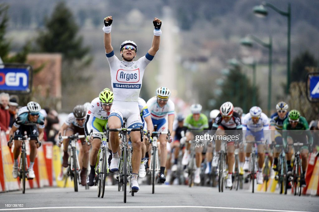 Team Argos-Shimano's German cyclist <a gi-track='captionPersonalityLinkClicked' href=/galleries/search?phrase=Marcel+Kittel&family=editorial&specificpeople=4520423 ng-click='$event.stopPropagation()'>Marcel Kittel</a> (C) celebrates as he crosses the finish line to win the second stage of the 71st Paris-Nice cycling race, between Vimory and Cerilly, on March 5, 2013. AFP PHOTO / JEFF PACHOUD
