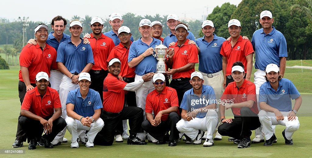 Team Asia and Team Europe celebrate together after the first EurAsia Cup finished in a tie. They are pictured after the single matches on day three of the EurAsia Cup at Glenmarie G&CC on March 29, 2014 in Kuala Lumpur, Malaysia.