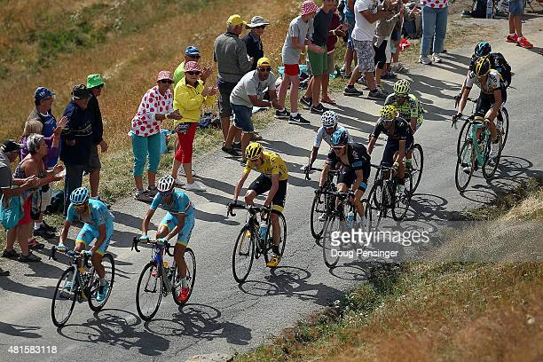 Team Astana and Vincenzo Nibali of Italy riding for Astana Pro Team lead the group of Chris Froome of Great Britain riding for Team Sky in the...