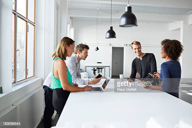 Team at design agency having a casual meeting