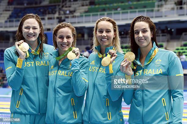 Team Australia Australia's Emma Mckeon Australia's Brittany Elmslie Australia's Bronte Campbell and Australia's Cate Campbell pose with their gold...