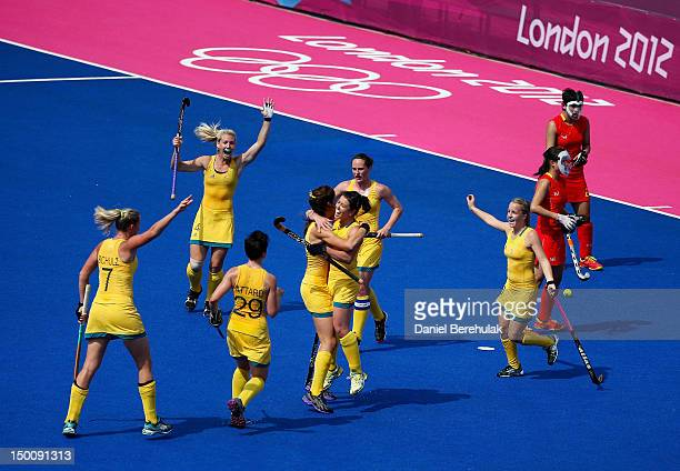 Team Australia celebrates a goal that was disallowed as team China looks on during the first half of the Women's Hockey classification match for 5th...