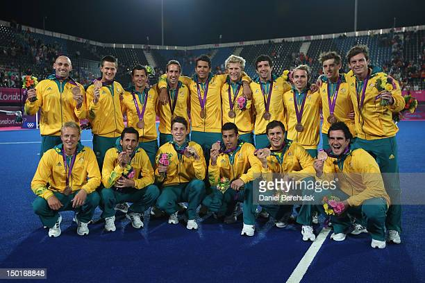 Team Australia celebrates with their bronze medals after the medal ceremony following the Men's Hockey gold medal match on Day 15 of the London 2012...