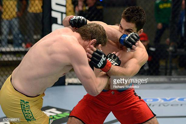 Team Australia fighter Daniel Kelly lands a forearm to the face of Team Canada fighter Sheldon Westcott in their middleweight fight during filming of...