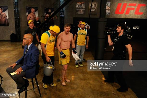Team Australia fighter Daniel Kelly walks to the locker room after being submitted by Team Canada fighter Sheldon Westcott in their middleweight...