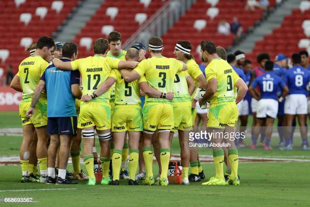 Team Australia huddles at the break during the 2017 Singapore Sevens match between Australia and Samoa at National Stadium on April 15 2017 in...