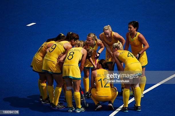 Team Australia huddles during the second half against China during the Women's Hockey classification match for 5th and 6th place between Australia...
