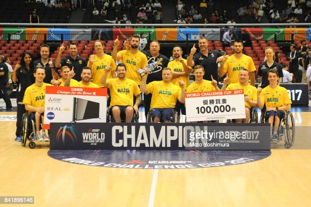 Team Australia poses for photographs with the trophy after the Wheelchair Basketball World Challenge Cup final between Australia and Great Britain at...