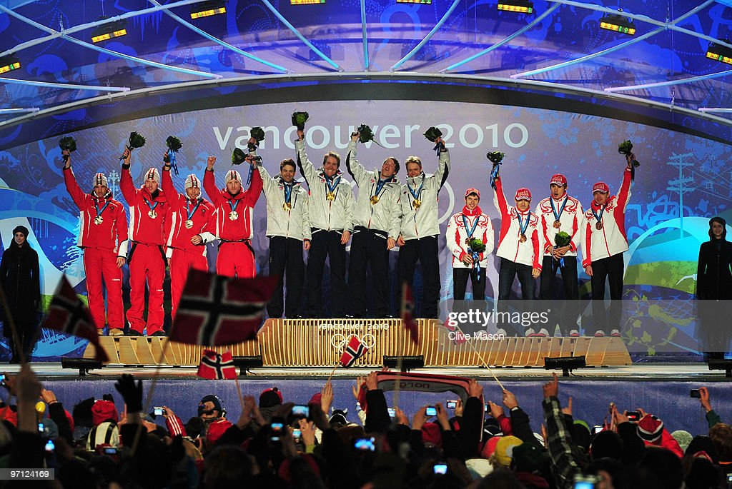Team Austria celebrates winning the silver medal, team Norway gold and team Russia bronze during the medal ceremony for the men�s 4 x 7.5 biathlon relay on day 15 of the Vancouver 2010 Winter Olympics at Whistler Medals Plaza on February 26, 2010 in Whistler, Canada.