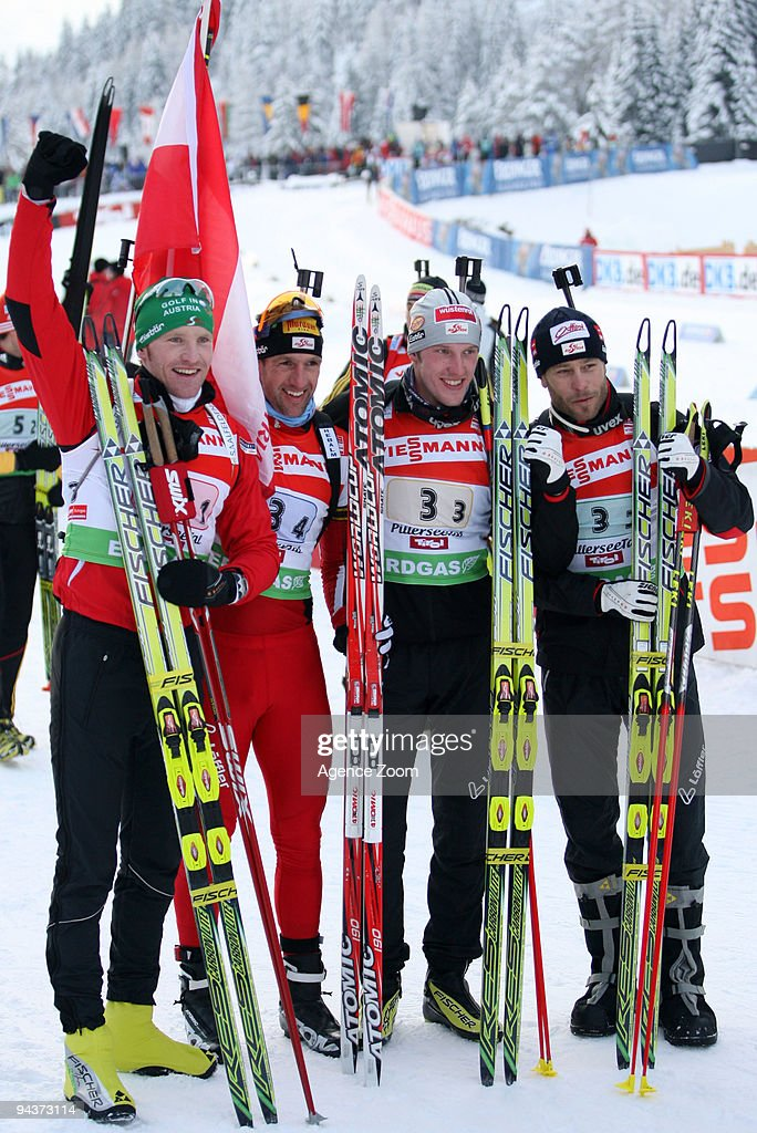 Team Austria (Simon Eder; Daniel Mesotitsch, <a gi-track='captionPersonalityLinkClicked' href=/galleries/search?phrase=Dominik+Landertinger&family=editorial&specificpeople=4698843 ng-click='$event.stopPropagation()'>Dominik Landertinger</a>; <a gi-track='captionPersonalityLinkClicked' href=/galleries/search?phrase=Christoph+Sumann&family=editorial&specificpeople=732936 ng-click='$event.stopPropagation()'>Christoph Sumann</a>) take 1st place during the e.on Ruhrgas IBU Biathlon World Cup Men's 4 x 7.5 km Relay on December 13, 2009 in Hochfilzen, Austria.