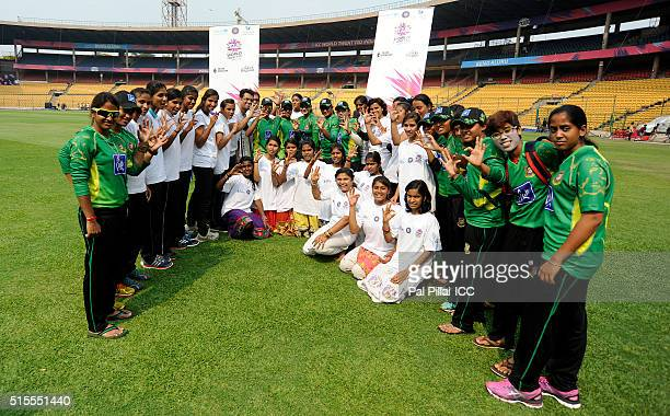 Team Bangladesh poses with the local kids during an Women's ICC World Twenty20 India 2016 Team Swachh cricket clinic in partnership with UNICEF at...