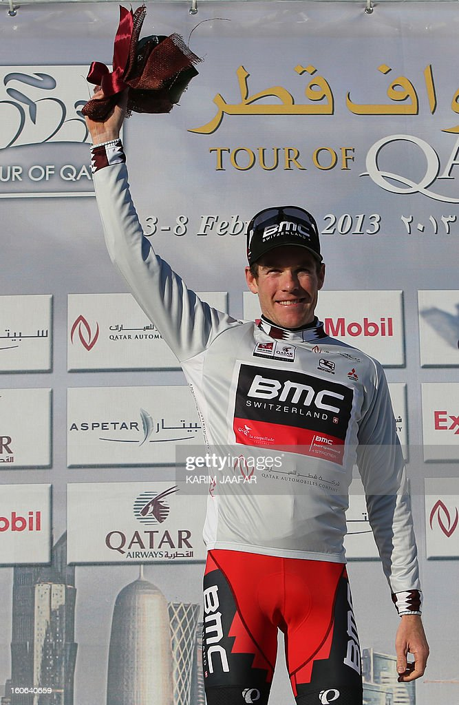 US team BMC's cyclist Brent Bookwalter celebrates after receiving the sprinter's silver jersey at the end of the second stage of the 2013 cycling Tour of Qatar, a 14-kilometre team time-trial, in the Qatari capital Doha, on February 4, 2013. BMC won the event which means that Bookwalter also keeps the leader's golden jersey in the overall classification, ahead of his compatriot Taylor Phinney and Britain's Adam Blythe AFP PHOTO / AL-WATAN DOHA / KARIM JAAFAR == QATAR OUT ==