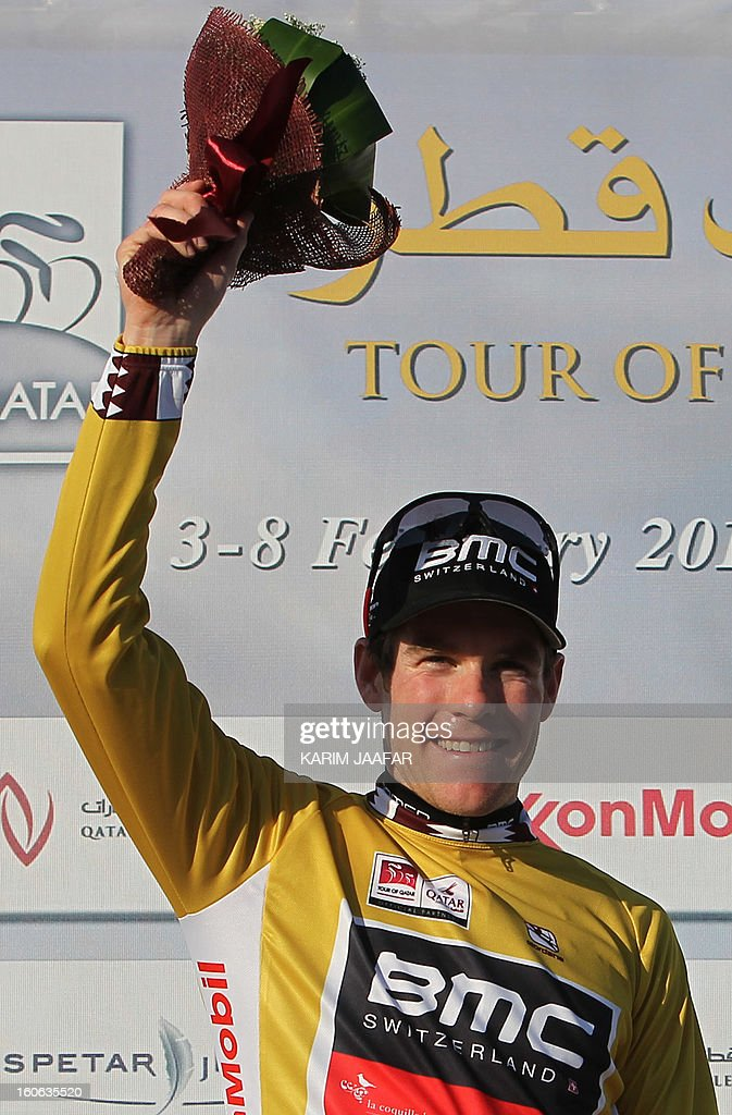 US team BMC's cyclist Brent Bookwalter celebrates on the podium after his team won the second stage of the 2013 cycling Tour of Qatar, a 14-kilometre team time-trial, in the Qatari capital Doha, on February 4, 2013. The victory, clocked in 16min 7.21sec, brought the team home five seconds ahead of Britain's Team Sky and 10 seconds in front of Omega Pharma, led by former world champion Mark Cavendish. AFP PHOTO / AL-WATAN DOHA / KARIM JAAFAR == QATAR OUT ==
