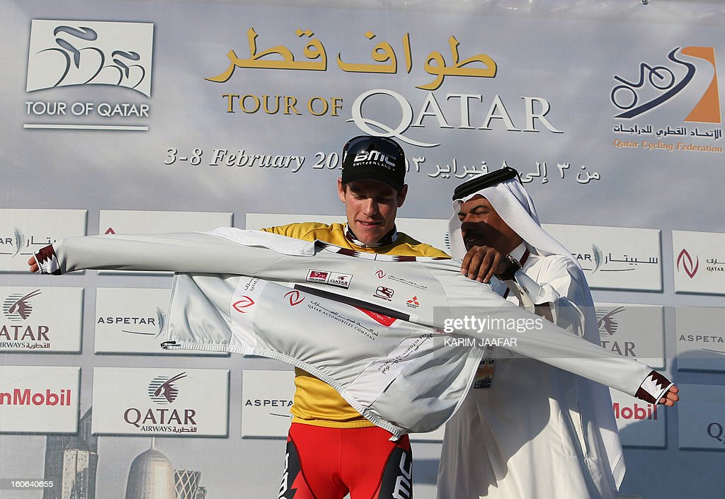 US team BMC's cyclist Brent Bookwalter receives the sprinter's silver jersey at the end of the second stage of the 2013 cycling Tour of Qatar, a 14-kilometre team time-trial, in the Qatari capital Doha, on February 4, 2013. BMC won the event which means that Bookwalter also keeps the leader's golden jersey in the overall classification, ahead of his compatriot Taylor Phinney and Britain's Adam Blythe AFP PHOTO / AL-WATAN DOHA / KARIM JAAFAR == QATAR OUT ==