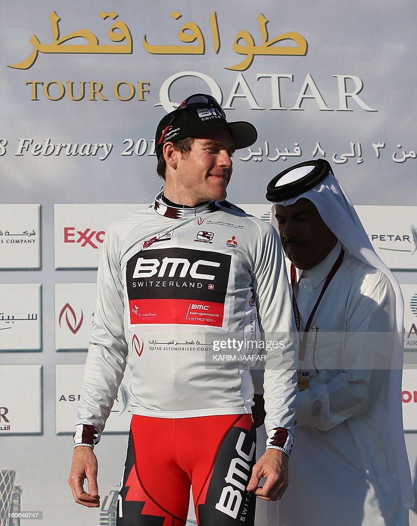 US team BMC's cyclist Brent Bookwalter receives the sprinter's silver jersey at the end of the second stage of the 2013 cycling Tour of Qatar, a 14-kilometre team time-trial, in the Qatari capital Doha, on February 4, 2013. BMC won the event which means that Bookwalter also keeps the leader's golden jersey in the overall classification, ahead of his compatriot Taylor Phinney and Britain's Adam Blythe