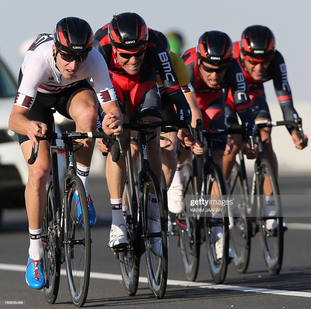 US team BMC's cyclists ride their bikes during the second stage of the 2013 cycling Tour of Qatar, a 14-kilometre team time-trial, in the Qatari capital Doha, on February 4, 2013. BMC won the event in 16min 7.21sec, five seconds ahead of Britain's Team Sky and 10 seconds in front of Omega Pharma, led by former world champion Mark Cavendish. (L) BMC's leader, Taylor Phinney. AFP PHOTO / AL-WATAN DOHA / KARIM JAAFAR == QATAR OUT ==