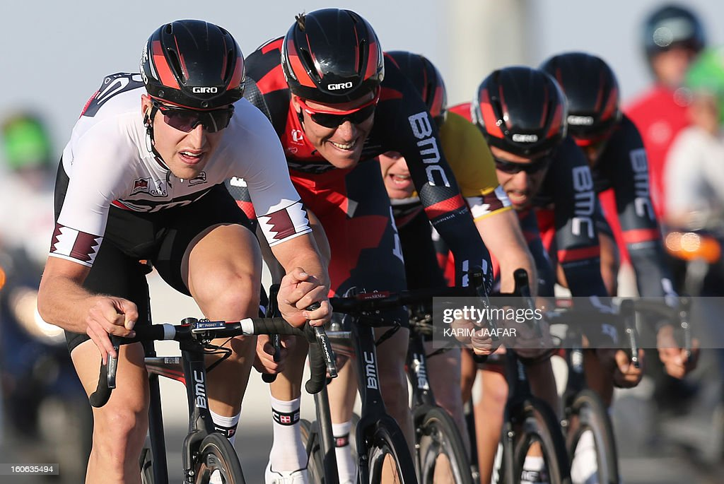 US team BMC's cyclists ride their bikes during the second stage of the 2013 cycling Tour of Qatar, a 14-kilometre team time-trial, in the Qatari capital Doha, on February 4, 2013. BMC won the event in 16min 7.21sec, five seconds ahead of Britain's Team Sky and 10 seconds in front of Omega Pharma, led by former world champion Mark Cavendish. (L) BMC's leader, Taylor Phinney.