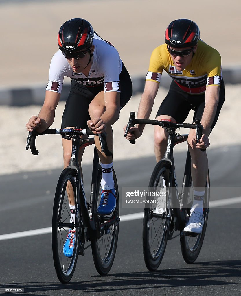 US team BMC's leader, Taylor Phinney (L) and teammate Gold jersey Brent Bookwalter ride their bikes during the second stage of the 2013 cycling Tour of Qatar, a 14-kilometre team time-trial, in the Qatari capital Doha, on February 4, 2013. BMC won the event in 16min 7.21sec, five seconds ahead of Britain's Team Sky and 10 seconds in front of Omega Pharma.