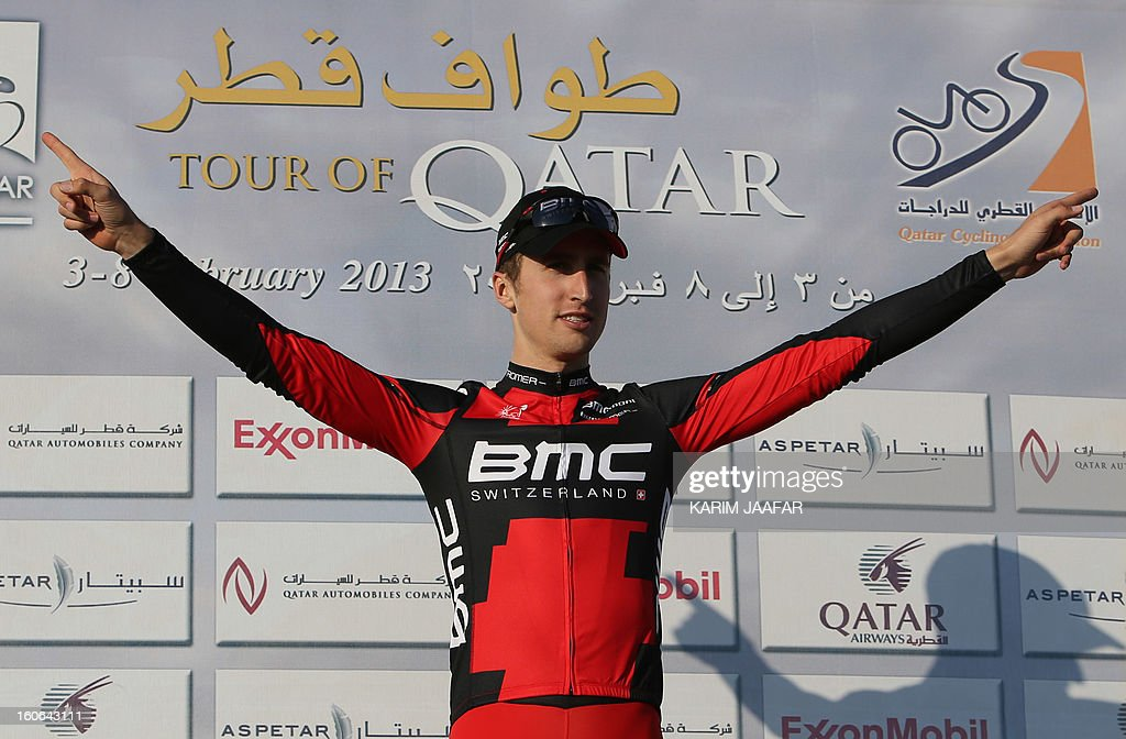 US team BMC's leader Taylor Phinney celebrates on the podium before receiving the Best Young White jersey at the end of the second stage of the 2013 cycling Tour of Qatar, a 14-kilometre team time-trial, in the Qatari capital Doha, on February 4, 2013. BMC won the event in 16min 7.21sec, five seconds ahead of Britain's Team Sky and 10 seconds in front of Omega Pharma. AFP PHOTO / AL-WATAN DOHA / KARIM JAAFAR == QATAR OUT ==