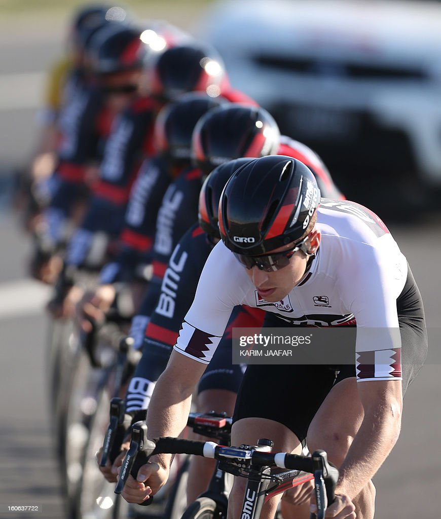 US team BMC's leader, Taylor Phinney (R) leads his team during the second stage of the 2013 cycling Tour of Qatar, a 14-kilometre team time-trial, in the Qatari capital Doha, on February 4, 2013. BMC won the event in 16min 7.21sec, five seconds ahead of Britain's Team Sky and 10 seconds in front of Omega Pharma, led by former world champion Mark Cavendish.