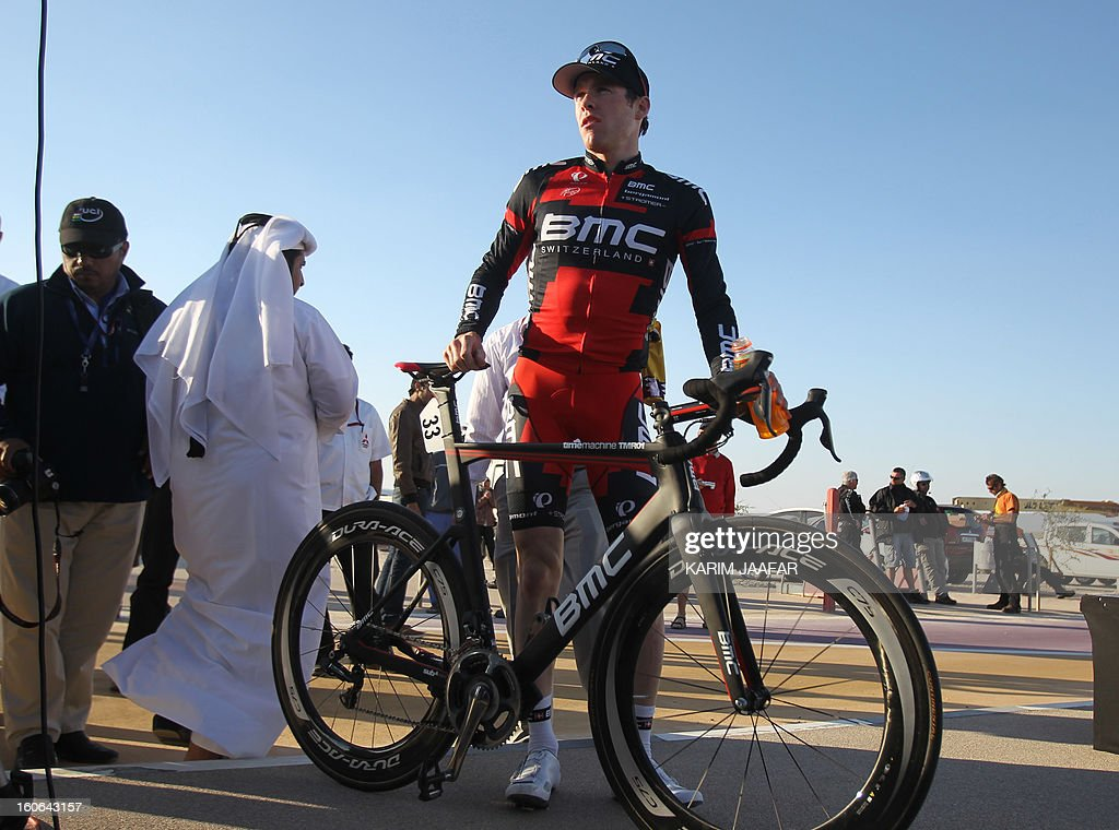 US team BMC's leader Taylor Phinney poses near his bike at the end of the second stage of the 2013 cycling Tour of Qatar, a 14-kilometre team time-trial, in the Qatari capital Doha, on February 4, 2013. BMC won the event in 16min 7.21sec, five seconds ahead of Britain's Team Sky and 10 seconds in front of Omega Pharma.
