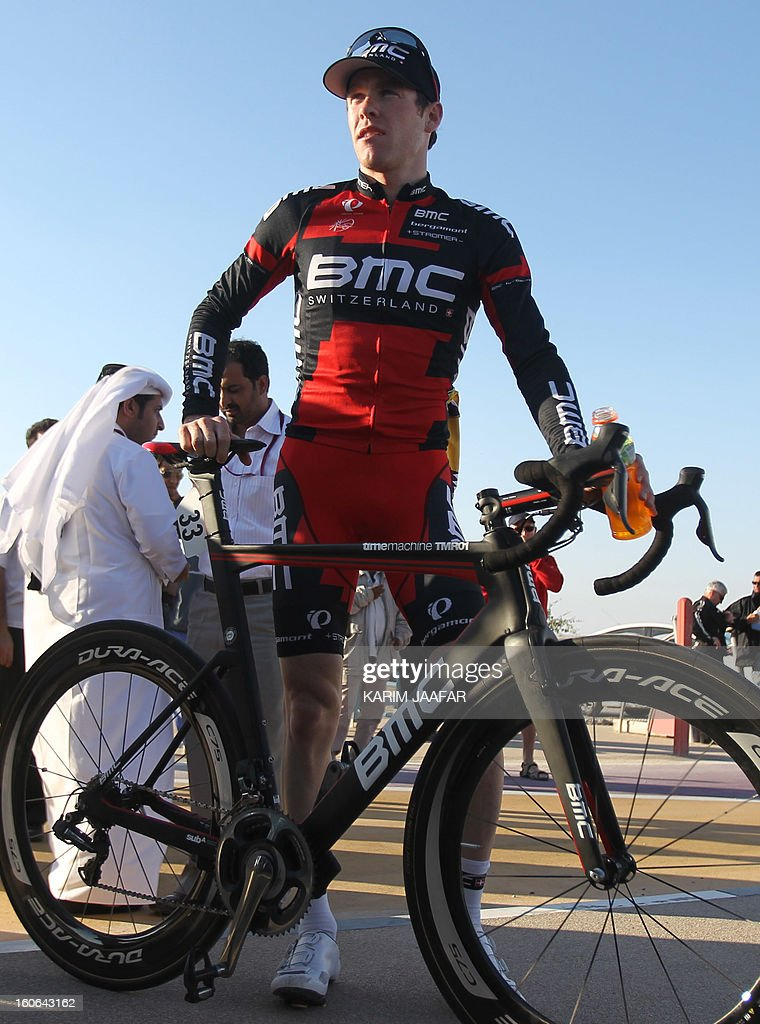 US team BMC's leader Taylor Phinney poses near his bike at the end of the second stage of the 2013 cycling Tour of Qatar, a 14-kilometre team time-trial, in the Qatari capital Doha, on February 4, 2013. BMC won the event in 16min 7.21sec, five seconds ahead of Britain's Team Sky and 10 seconds in front of Omega Pharma. AFP PHOTO / AL-WATAN DOHA / KARIM JAAFAR == QATAR OUT ==