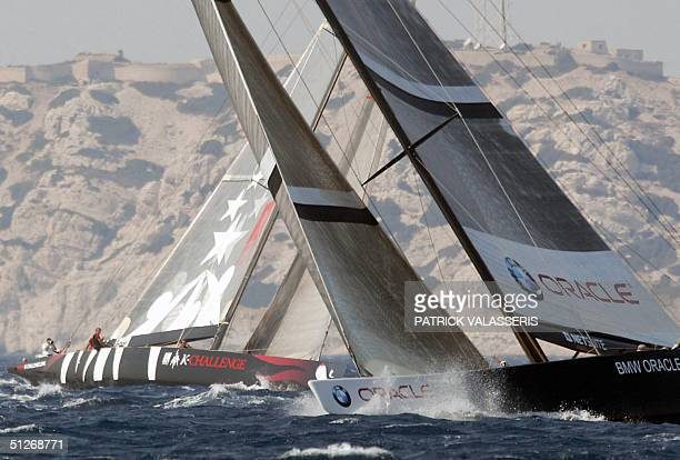 US team BMW Oracle manoeuvres past French team KChallenge prior to the start of the prerace of the Marseille LouisVuitton act qualifying for the 2007...
