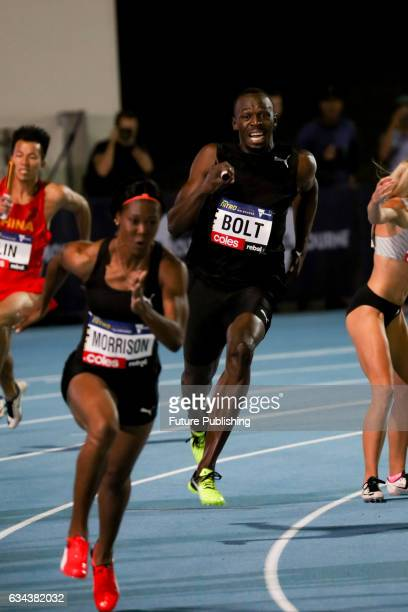 Team Bolt All Star's Usain Bolt passes the baton to Natasha Morrison in the mixed 4x100m relay on night 2 of Nitro Athletics on February 9 2017 in...