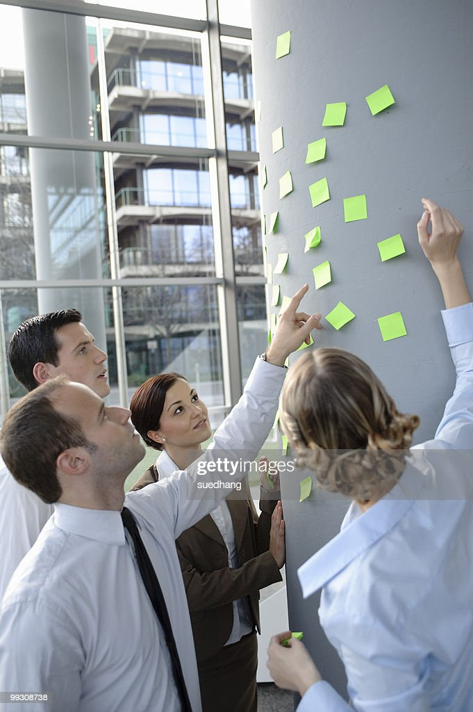 Team brainstorming with sticky notes : Stock Photo