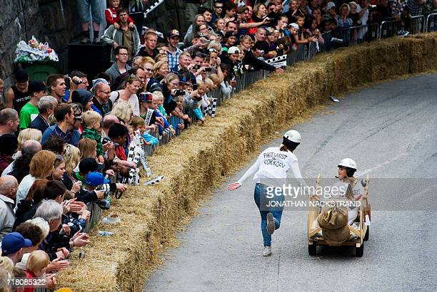 Team 'Bratwurst o Kokkorv' ride in a homemade race gokart during Stockholm's Red Bull Soapbox race on July 3 2011 Participants compete in homemade...