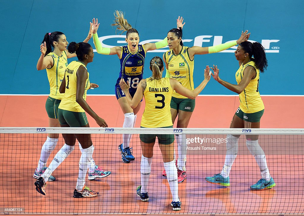 Team Brazil celebrate after winning a point against Japan during the FIVB World Grand Prix Final group one match between Brazil and Japan on August 24, 2014 in Tokyo, Japan.