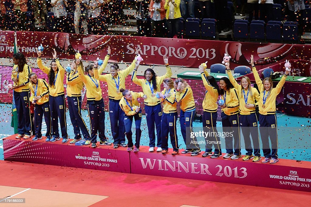 Team Brazil celebrate on the podium after receiving the gold medal during awards ceremony for the FIVB World Grand Prix Sapporo 2013 at Hokkaido Prefectural Sports Center on September 1, 2013 in Sapporo, Hokkaido, Japan.
