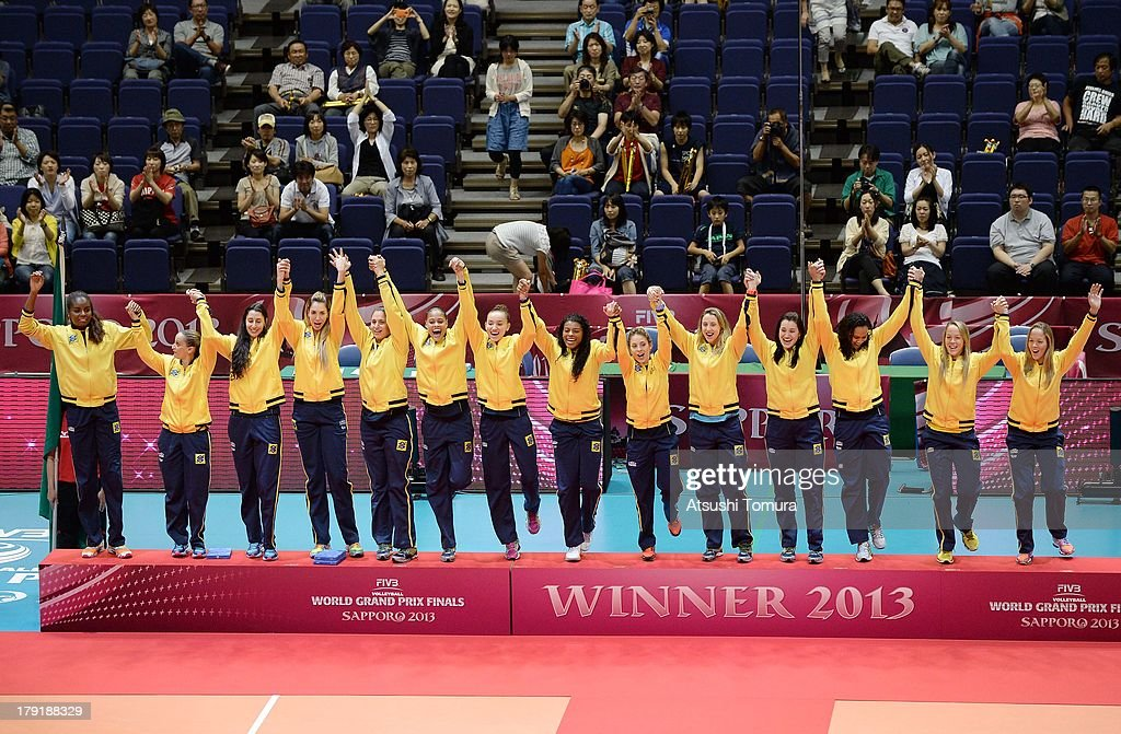 Team Brazil celebrate on the podium during awards ceremony for the FIVB World Grand Prix Sapporo 2013 at Hokkaido Prefectural Sports Center on September 1, 2013 in Sapporo, Hokkaido, Japan.