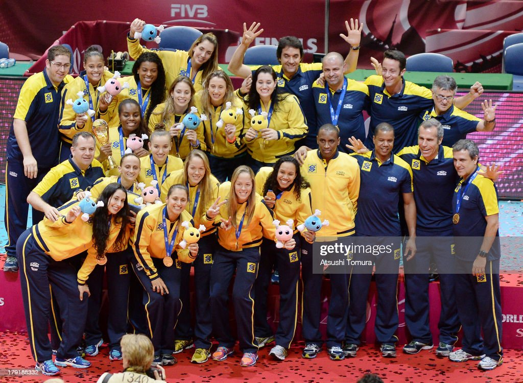 Team Brazil players and support staff pose for photographes on the podium after winning the gold medal during awards ceremony for the FIVB World Grand Prix Sapporo 2013 at Hokkaido Prefectural Sports Center on September 1, 2013 in Sapporo, Hokkaido, Japan.