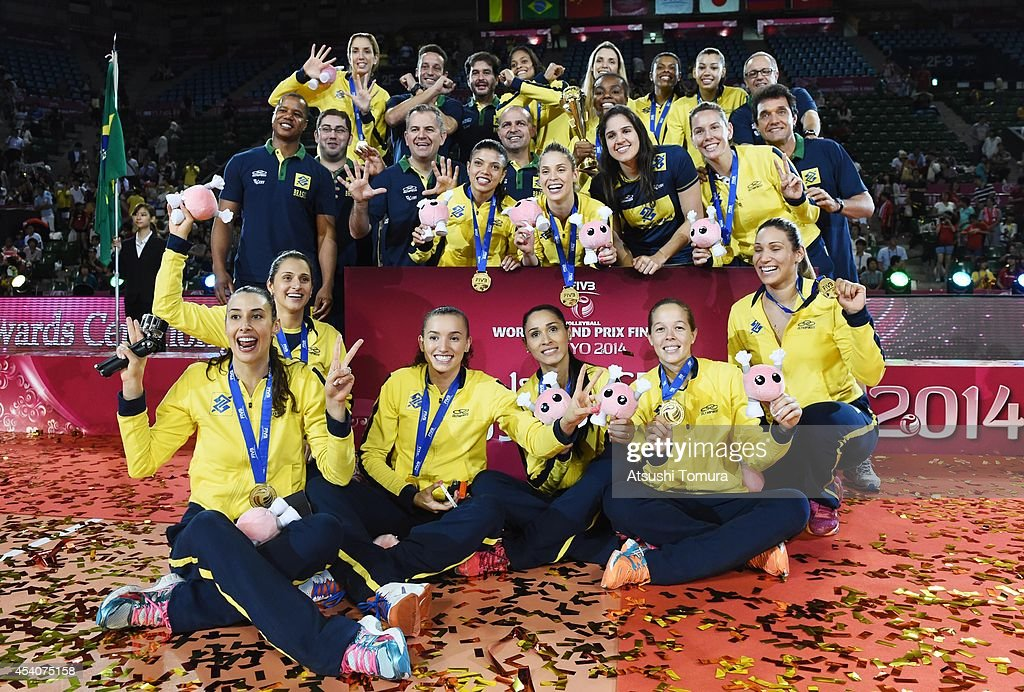 Team Brazil pose for photo with gold medal during the FIVB World Grand Prix Final group one match between Brazil and Japan on August 24, 2014 in Tokyo, Japan.