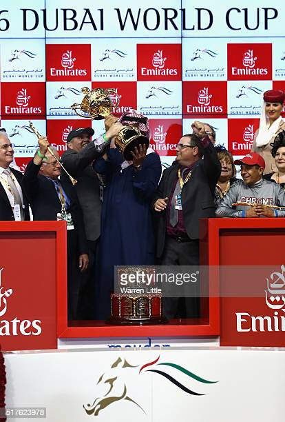 Team California Chrome celebrates with the trophy after victory in the Dubai World Cup Sponsored By Emirates Airline as part of the Dubai World Cup...