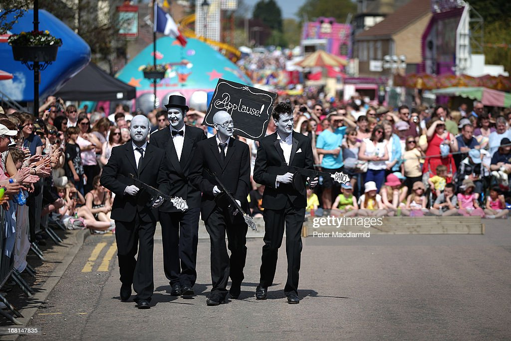 A team called 'Fromage to the Silver Screen' parades before taking part in the Stilton Village Festival cheese rolling competition on May 6, 2013 in Stilton, England. Local people are currently involved in a campaign to bring Stilton cheese making back to the village. The cheese is currently made in the counties of Nottinghamshire, Leicestershire and Derbyshire .